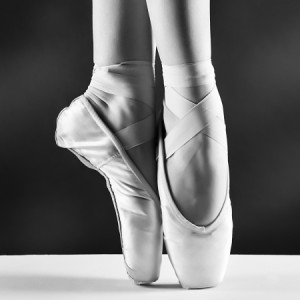 A beautifully subtle photo of a ballet dancer's feet as she is on pointe.